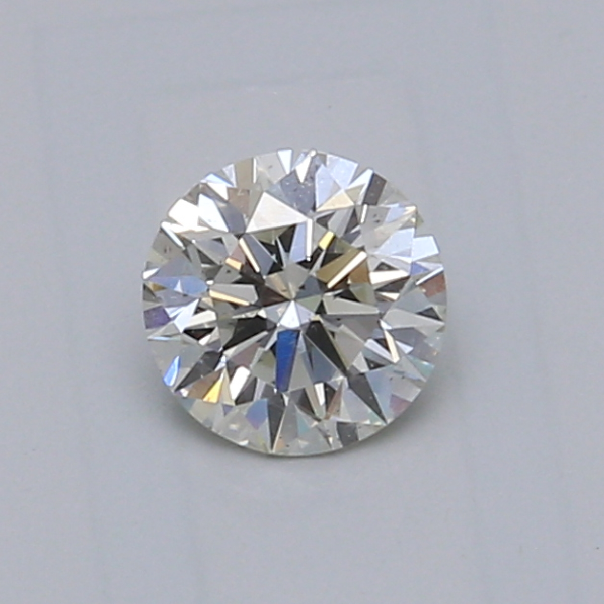 0.60 Carat K VS2 Round Diamond